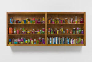 a bookshelf of colorful plastics
