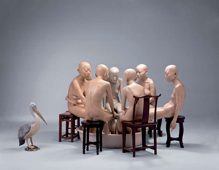 naked statues sitting in a circle
