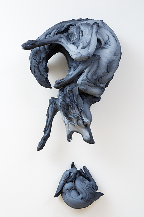 Wolf and rabbit sculpture by artist Beth Cavener