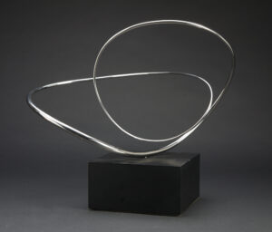 simple silver wire loop sculpture on black block
