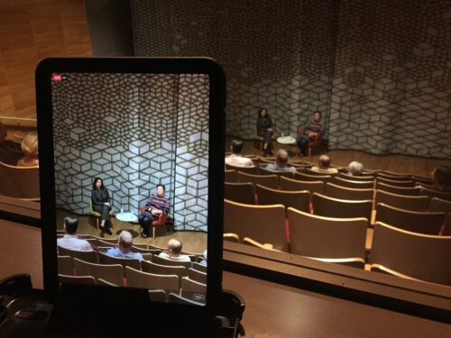 A lecture in the auditorium is shown on an iPad
