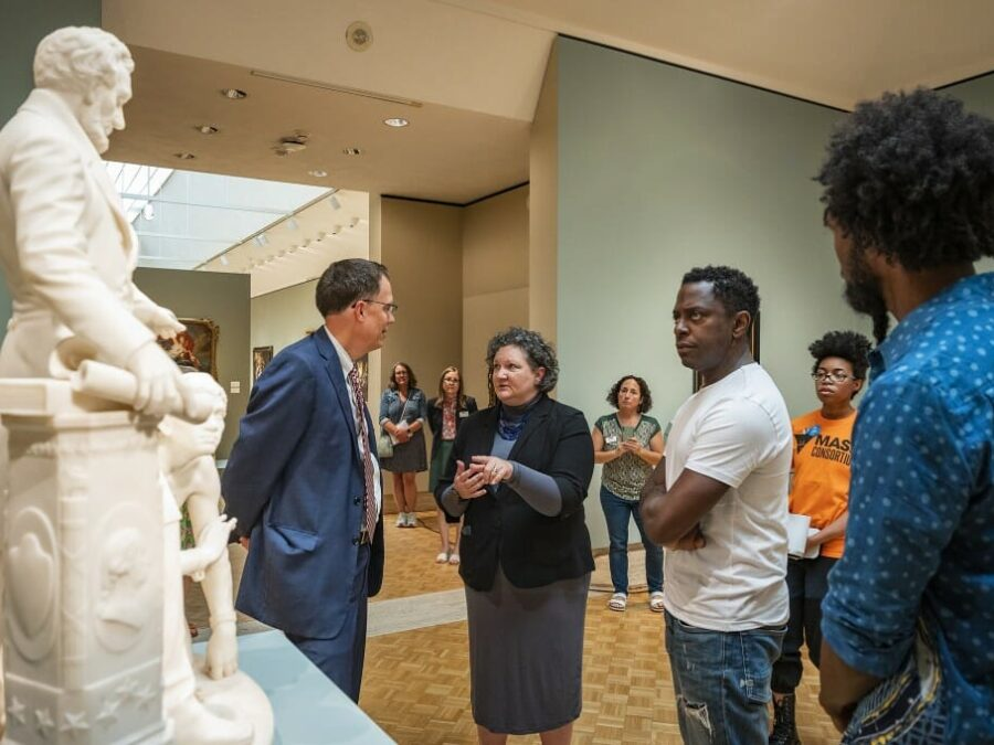 Artist Sanford Biggers (right), joined by Provost John Karl Scholz (left) and museum director Ay Gilman (center), visited the Chazen to plan for an upcoming exhibition that will respond to the 1873 Thomas Ball sculpture. Photo: Bryce Richter