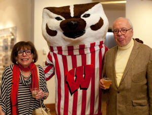 Johanna (l) and Leslie (r) Garfield are seen with Bucky Badger at the Fifth Birthday Party for the Chazen Building